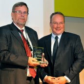 Dr Olle Grinder, of PM Technology AB, being presented the Distinguished Service Award for 2011.