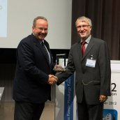 Dr. Volker Arnhold, formly of GKN Sinter Metals GmbH, being presented the Distinguished Service Award for 2012
